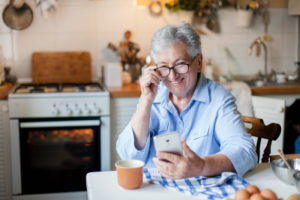 happy older lady with phone